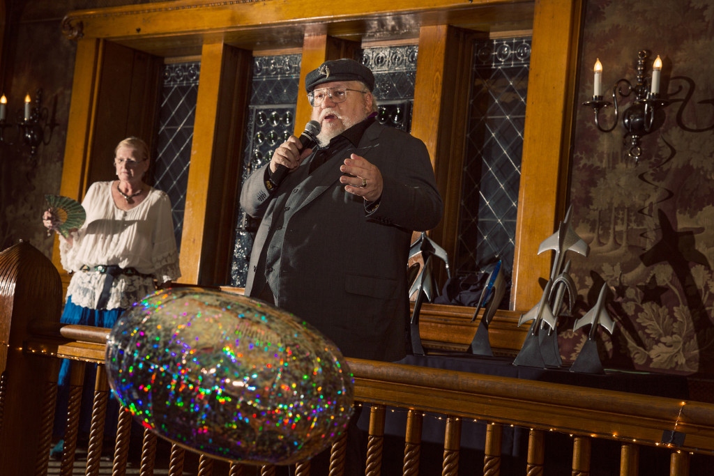 """George RR Martin hands out his own """"Alphie"""" awards at the Hugo Losers Party, August 23, 2015."""
